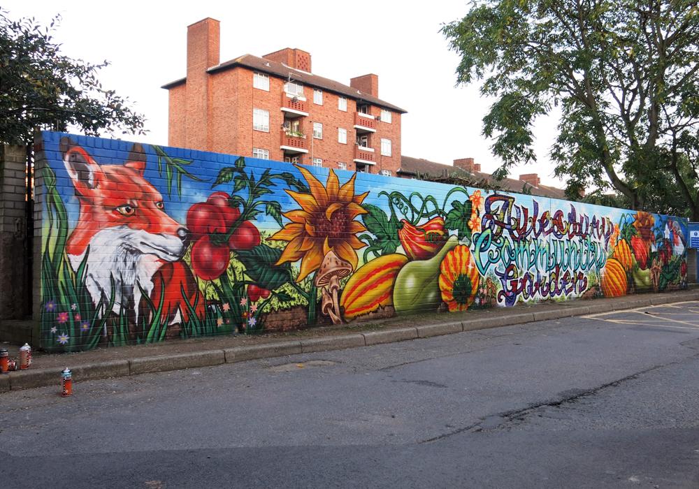 Aylesbury estate community garden graffiti mural for Community mural
